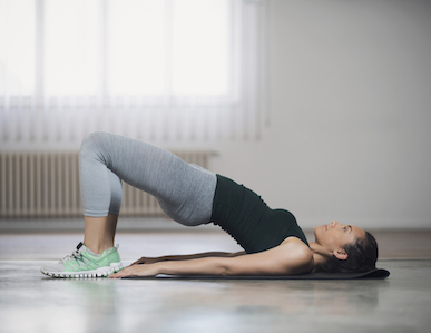 woman stretching bridge, pilates, resistance stretching, healthista.com featured .jpg