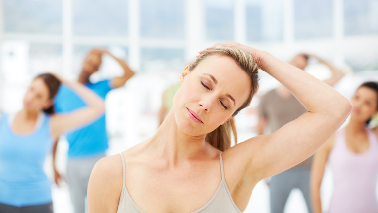 woman stretching neck, resistance training, pilates, stretch, healthista.com.jpg