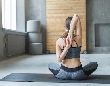 woman stretching shoulder, pilates, healthista.com.jpg