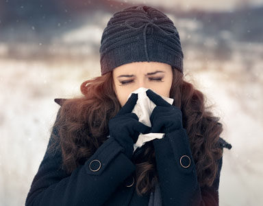 lady-blowing-nose,-nutrients-to-boost-immunity-by-healthista.com
