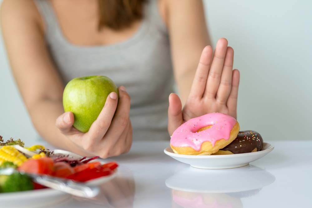 60-weight-loss-tips-in-60-days-New-Year-Revolution-woman-saying-no-to-doughnuts