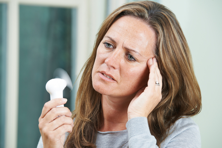 natural-ways-to-ease-menopause-woman-with-electric-fan.jpg