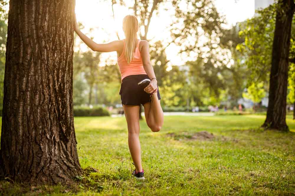 12-tips-to-boost-your-fertility-woman-exercising-outdoors.jpg