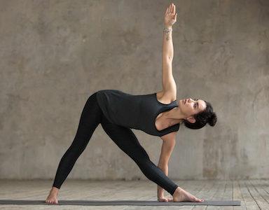 Triangle pose Healthista 30 day yoga challenge Sarah Malcolm