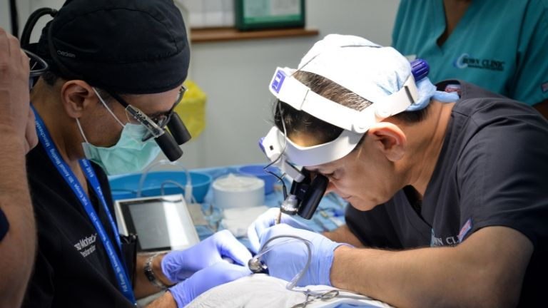 eyelash transplant - doctor performing surgery