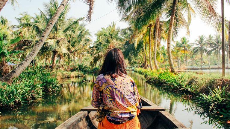 21 solo travel secrets - woman on boat -main