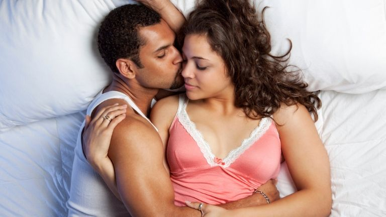 7 ways to use tantric sex to improve your love life - couple cuddling - in post 3