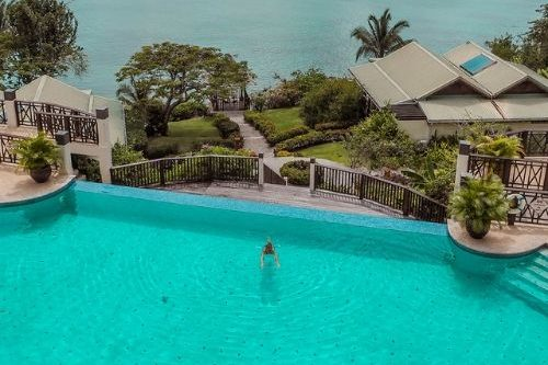 St Lucia resort - blue water and pool