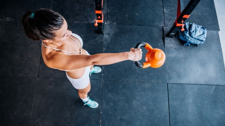This arm workout using a kettlebell will get you bicep-confident fast
