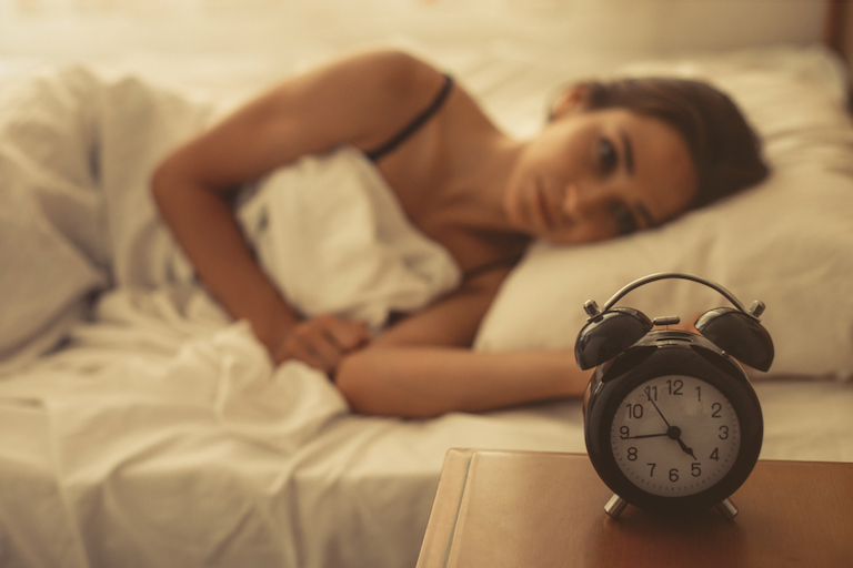 Woman-cant-sleep-causes-of-tiredness-healthista