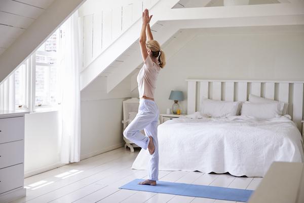 woman-doing-yoga-mindfulness-healthista