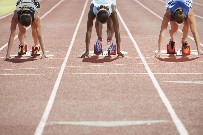 Runners in starting blocks healthista