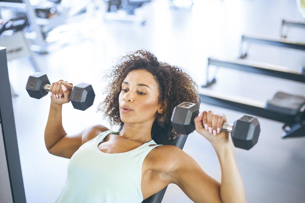 weight-training-woman-shoulder-press.jpg