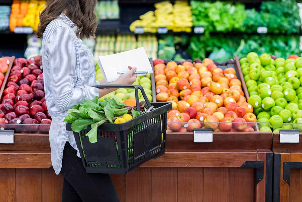 Veganuary-How-to-go-plant-based-the-Doctors-guide-fruits-and-veggies-woman-shopping-in-supermarket.jpg