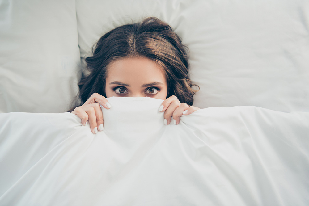 9-natural-ways-to-get-a-better-nights-sleep-woman-in-bed-awake.jpg