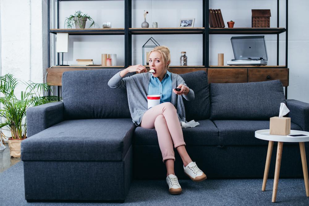 Woman-on-sofa-eating-ice-cream-stress-fixer.jpg