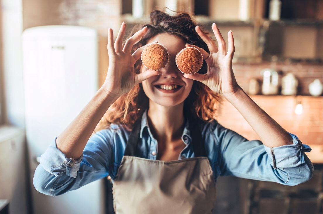 Woman baking cupcakes how to be happier