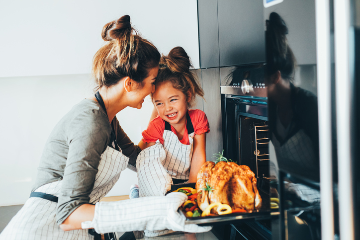 9-helpful-tips-for-a-healthy-happy-Christmas-embrace-the-small-moments-mother-and-daughter-cooking.jpg