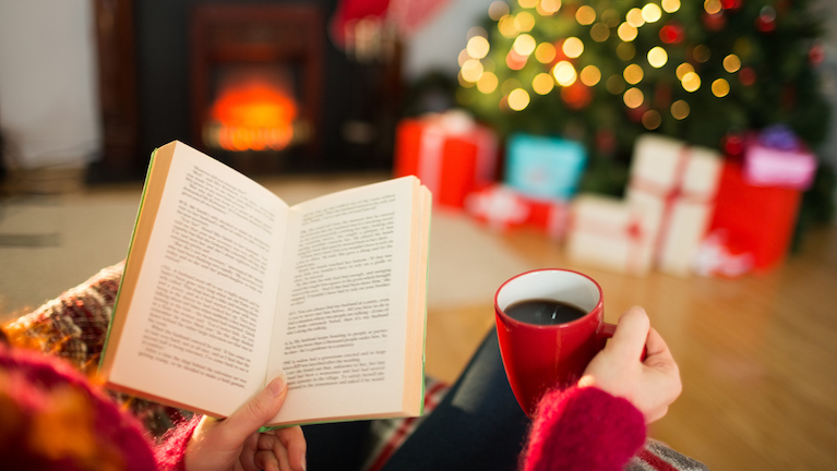 9-helpful-tips-for-a-healthy-happy-Christmas-woman-reading-a-book-at-christmas.jpg