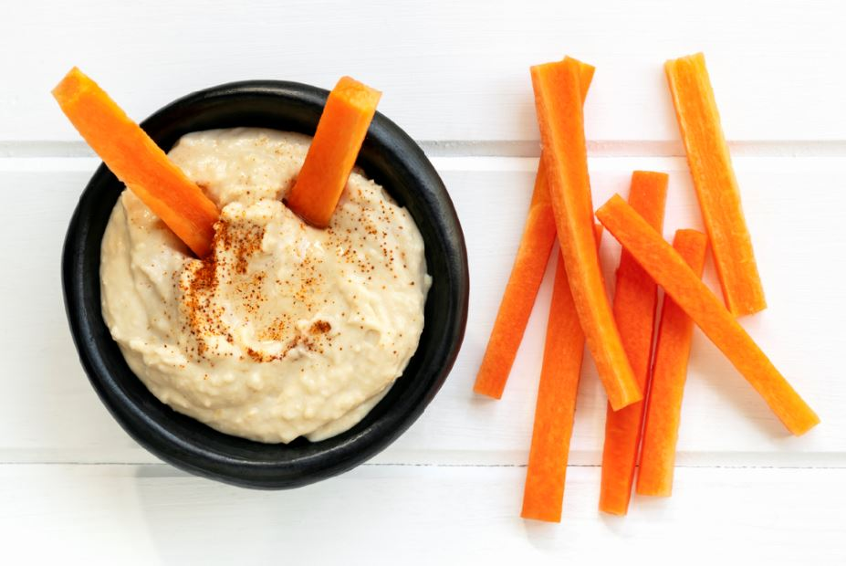 Healthy snacks to keep you full on the move carrots and houmous