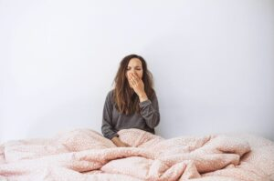 5 ways your exercise routine could be messing with your sleep woman yawning