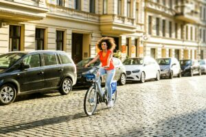 4 ways you can change your relationship with exercise woman on bike
