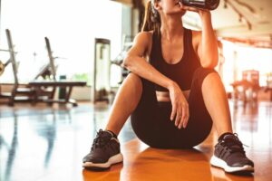 5 ways turmeric can help you make the most out of your workout woman drinking water and recovering after exercise