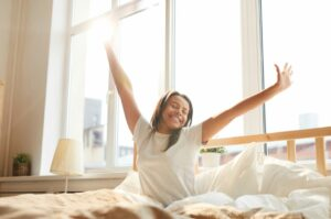 5 ways turmeric can help you make the most out of your workout woman wide awake and stretching in bed