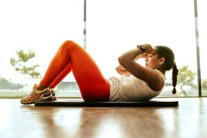 No motivation to exercise? 8 ways to convince yourself to workout when you don't want to woman working out
