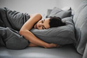 3 ways CBD can make your workouts better woman sleeping