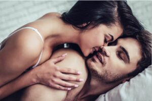 5 ways to convince your partner to use sex toys & spice things up in the bedroom Couple in bed