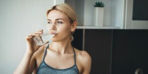 hairdressers guide to healthy, shiny hair stay hydrated woman drinking water